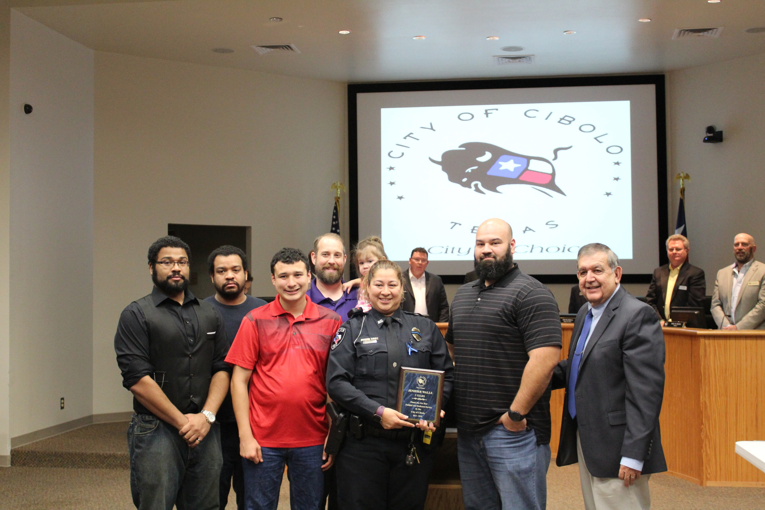 Mr. Herrera Presentation of 5 Years Service Award to Officer Jennifer Walls. (Picture with Family)